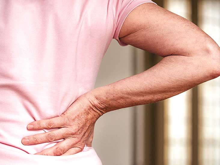 What should I do if my lower back hurts after sleeping?